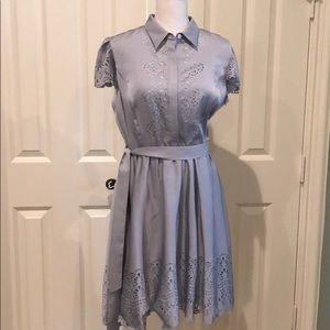 Pretty grey dress with lots of details.